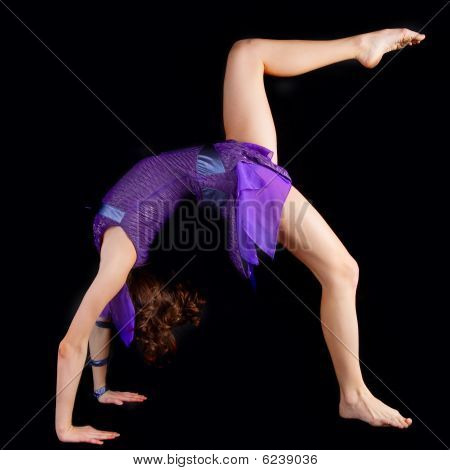 Young Yoga Female Doing Yogatic Exericise .