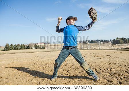 Boy pitching a baseball