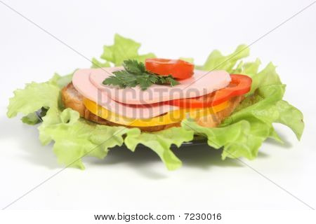 Ham Sandwich With Ripe Potato, Sweet Red And Yellow Pepper And Greenery