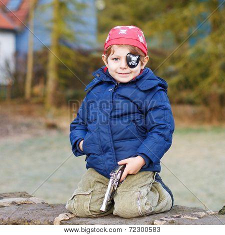 Little Preschool Boy Of 4 Years In Pirate Costume, Outdoors.