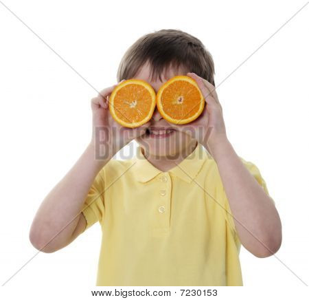 Conceptual image of a person holding oranges