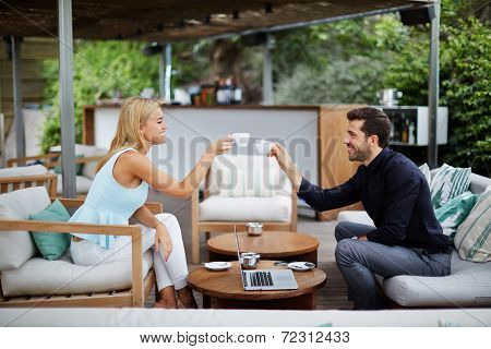 Business communication, joint work of two executive, businessman and businesswoman drinking coffee