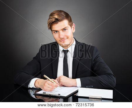Confident Businessman Working At Desk