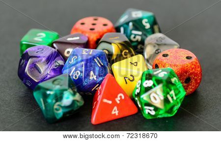 Role Playing Dices Lying On Black Background