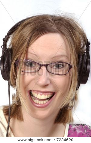 Girl With Glases And Headphones