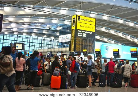 Travelers queuing at the airport