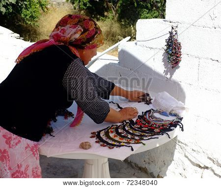 Village woman preparing her local stall