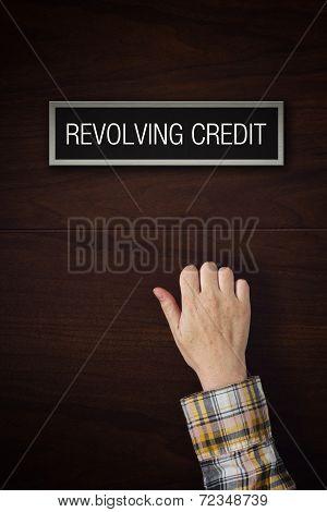 Hand Is Knocking On Revolving Credit Door