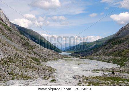 dried lake surrounded with mountains