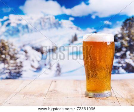 Glass Of Beer Over Winter Landscape