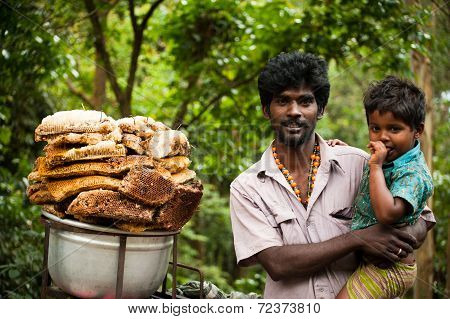 Local Indian Man And His Son Selling Wild Honey. Kerala India