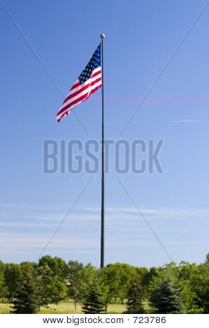 This flagpole is 338 feet tall and the flag is 60 feet by 120 feet. The pole base is six feet in diameter! Weight of the flag is 300 pounds, the pole is 65 tons! poster