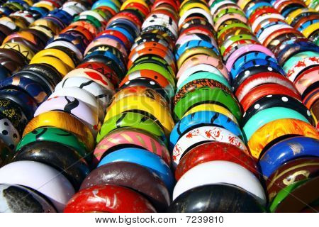 detail of colored wooden indien bracelets in the lines