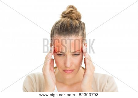 Woman with headache touching her temples on white background