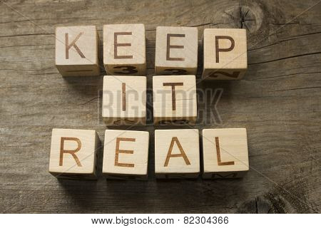 keep it real text on a wooden background poster