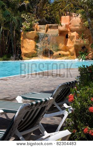 Tropical Pool Scene With Waterfall