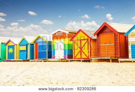 Beautiful Bathing houses on white sandy beach at Brighton in Melbourne, Australia.