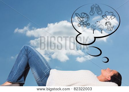Young woman lying on floor thinking against cloudy sky