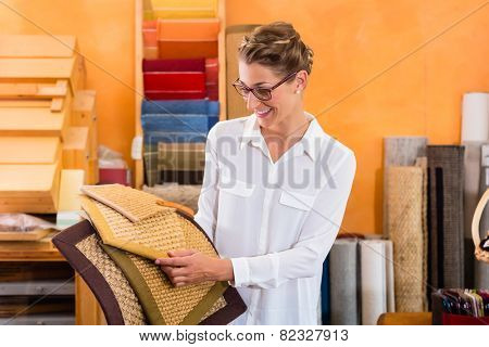 Interior Designer buying floor mats in home improvement store poster