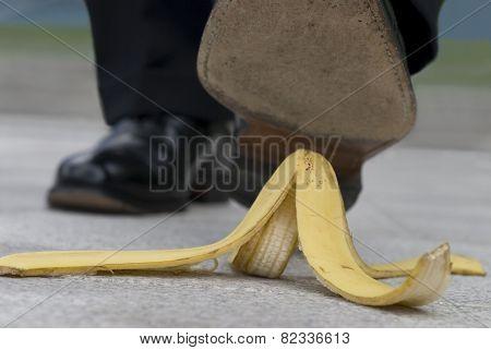 Businessman And Banana Skin