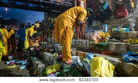 KUALA LUMPUR, MALAYSIA - FEBRUARY 3, 2015: Hindu devotees perform prayers at the Sri Mahamarriamman temple in Batu Caves. Hundreds of thousands of devotees come here for the Thaipusam prayers.