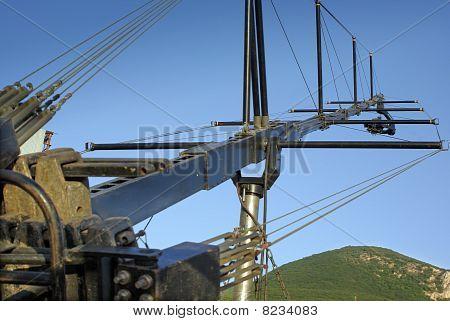 Camera On A Crane Against A Natural Landscape