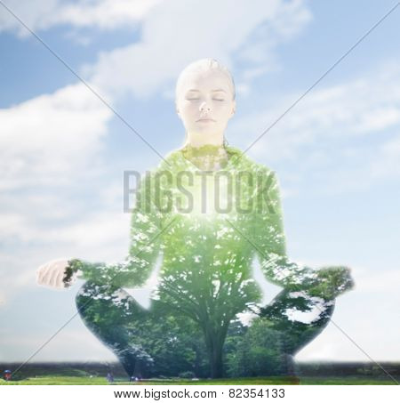 sport, fitness, yoga, double exposure and people concept - happy young woman meditating in lotus pose over blue sky and green tree background