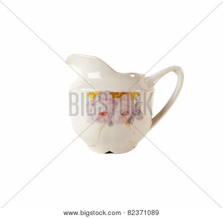 Porcelain Gravy boat with Rouse ornament isolated over white background