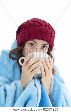 Woman Warming Herself Under A Blanket And With A Cup Of Tea