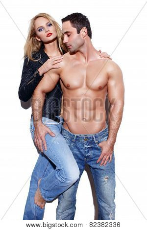 Sexy Couple In Jeans At White Wall