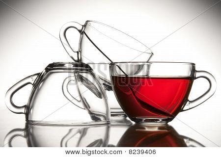 4 Tea Cups And Tea