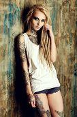 Modern girl with blonde dreadlocks. Jeans style. Modern generation. poster