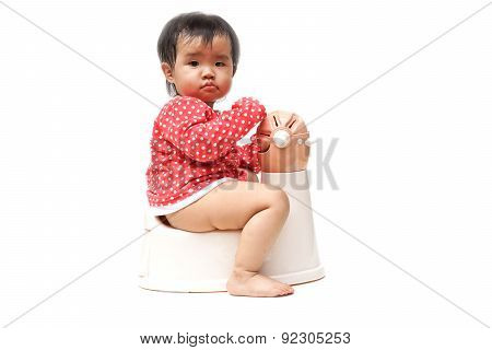 asian baby using and playing with toilet