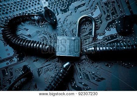 computer security breach due to worm attack - worm on computer circuit board with open security lock