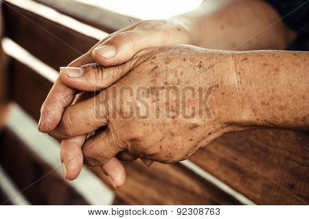 hands of a female elderly with freckles