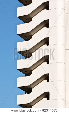 Fragment of a building with a regular staircase pattern