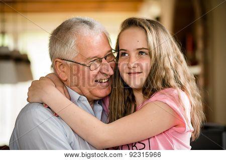 Grandfather and granddaghter hug