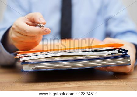 Manager Is Offering You Pen And  To Take The Documentation To Begin With Work