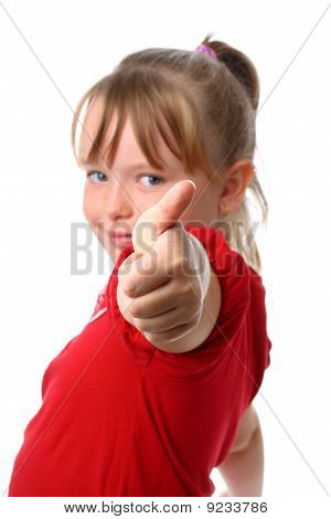 Small girl showing thumbs up gesture with thumb focused isolated on white