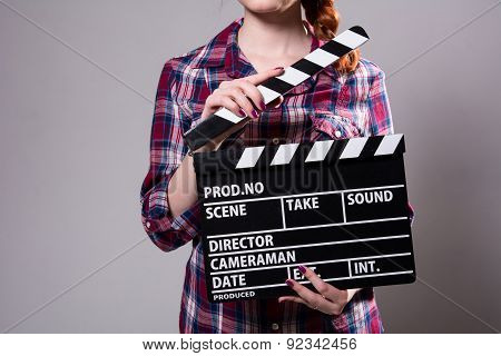 Close-up Of A Girl With A Movie Clapper