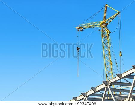 Hoisting Crane Against The Blue Sky With Space For Text
