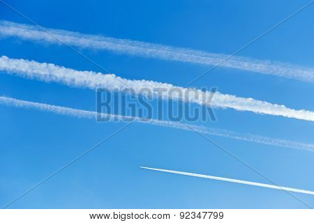 Contrails In The Blue Sky