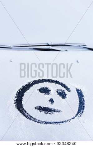 Face On The Hood Of The Car. First Snow