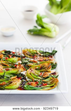 Roasted baby bok choy with spicy sauce and sesame seeds.Selective focus