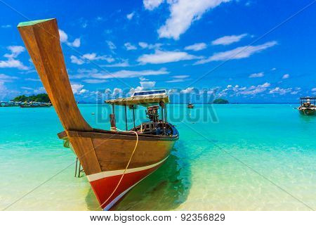 Wood Boat And Islands In Andaman Sea Against Blue Sky At Lipe