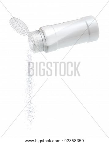 Salt Pour From Saltcellar On White Background