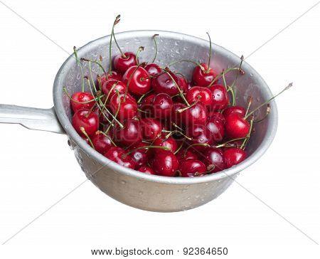 Fresh ripened red cherries in colander