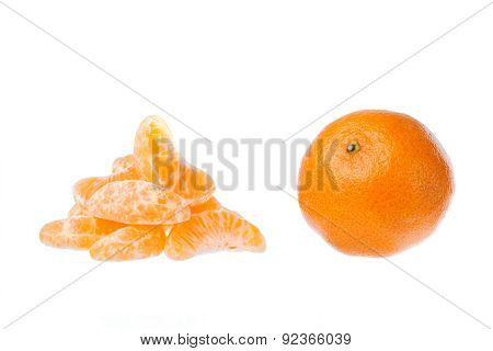 whole tangerine and lobules on a white background