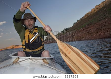 Mature Male In A Canoe