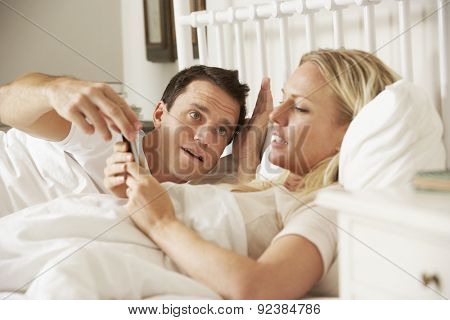 Husband Complaing As Wife Uses Mobile Phone In Bed